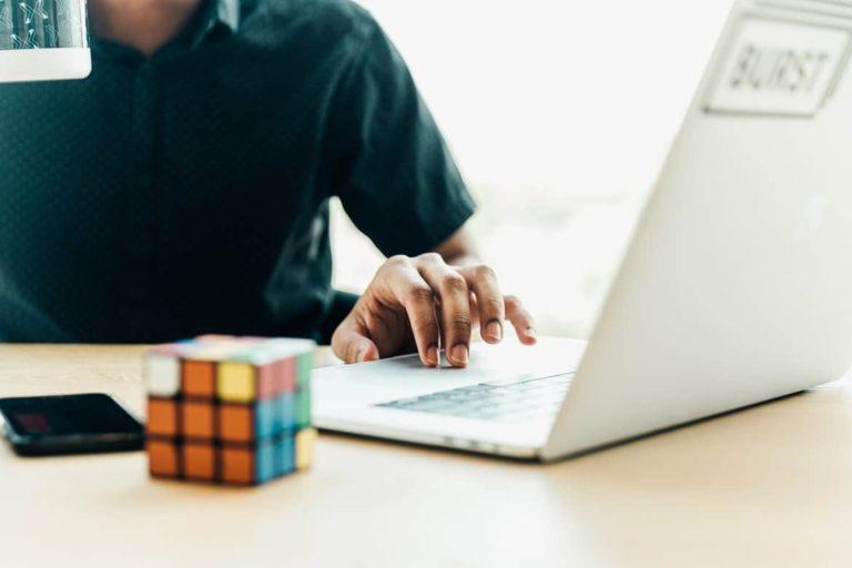 man-at-computer-using-trackpad